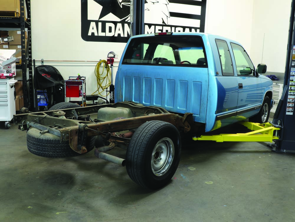 01 Aldan American being lifted on a Bendpak 2 post lift