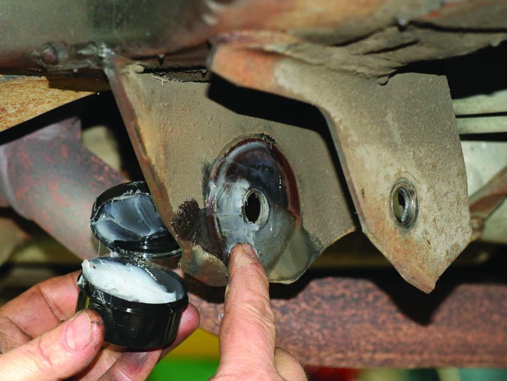 13 Stone Custom Fab tubular control arms using Summit Racing polyurethane bushing prelube