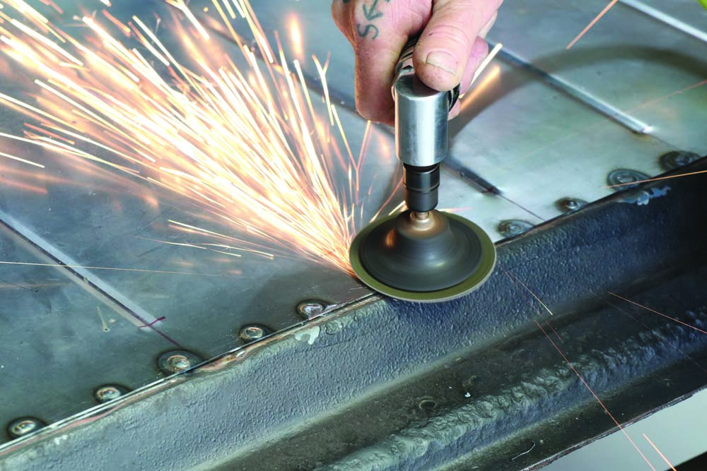 18 angle grinding spot welds for the spare tire delete