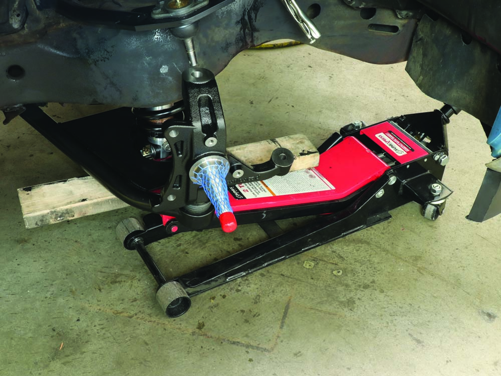 20 attaching the lower control arm to the Aldan coilovers