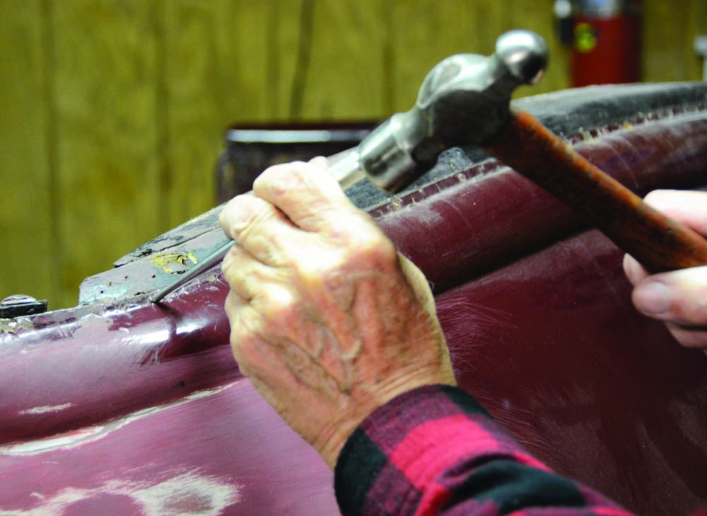 03 Flattening the metal with the chisel on the 1936 Phaeton