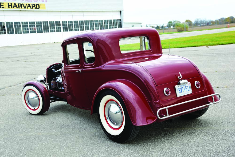 09 Deuce Coupe holds a vintage Ford Flathead and stainless steel exhaust system