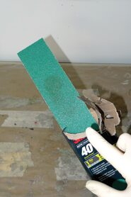 09 Five packs of sandpaper top sheet gets contaminated through the open portion of the package