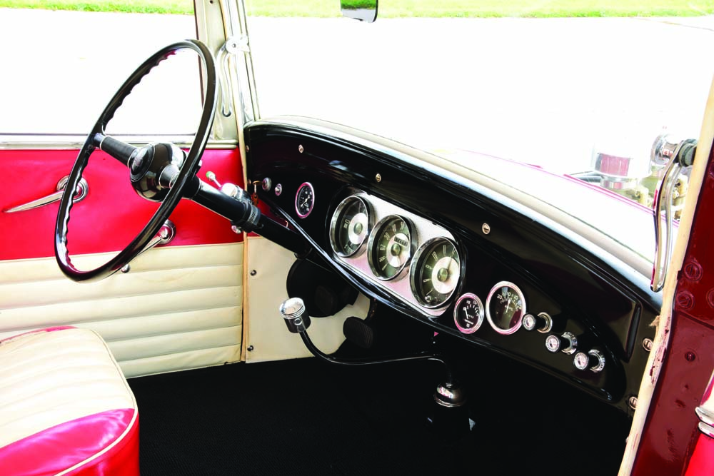 11 Old hot rod with Stewart-Warner gauges with a custom shifter and 1939 Ford transmission