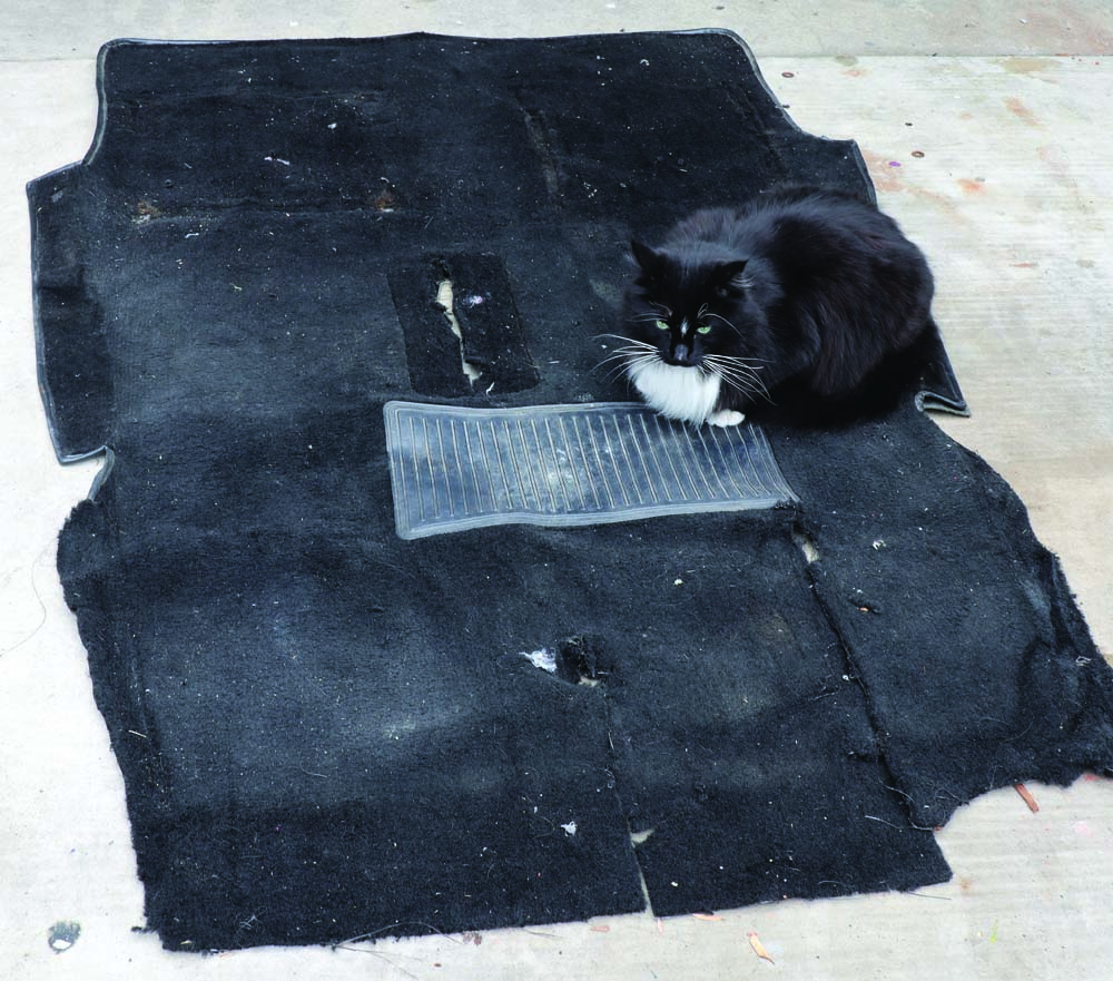 11 Using the old carpet as a template for the new carpet of this classic car restoration